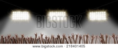 Raised hands in the dark on rock music concert. Hardrock music festival concept