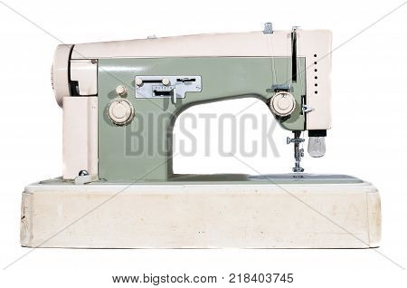 Vintage sewing machine on white background ready for sewing