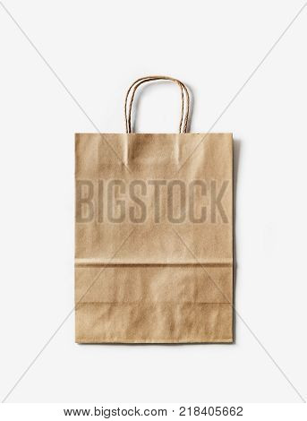 Blank craft paper bag on white paper background. Recyclable package. Template ready for your design.
