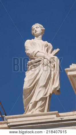ROME, ITALY - SEPTEMBER 02: St. Thecla, fragment of colonnade of St. Peters Basilica. Papal Basilica of St. Peter in Vatican is the center of Christianity in Rome, Italy on September 02, 2016.