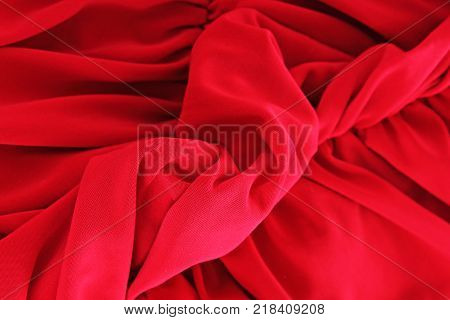Red silk fabric background. Sexy red silk fabric as background cover. Sexy illustration. Silk closeup texture pattern symbol of sex or bed scene. Red silk dress macro photo. Artsy cover.