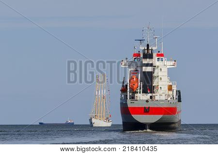SAILING VESSEL AND FREIGHTERS - Ships in the cruise on the sea