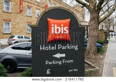 GREENWICH; LONDON; UNITED KINGDOM - MAR 10 2017: Hotel Parking at the IBIS Accor hotel sign in British city of Greenwich with empty price sign in pounds per day