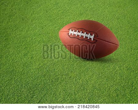 View of a plain football on synthetic turf grass.