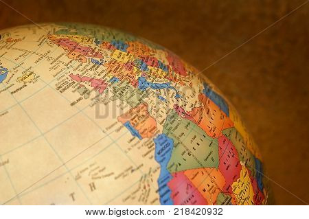 Close up side view of a globe.