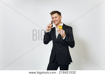 Young Successful Handsome Rich Business Man In Black Suit Holding Wad Of Cash Dollars Isolated On Wh