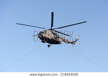 Koktebel, Crymea, Russia - September 28, 2016 Soviet Russian multipurpose helicopter, Mi-8mt during the flight over the beach of the resort village of Koktebel