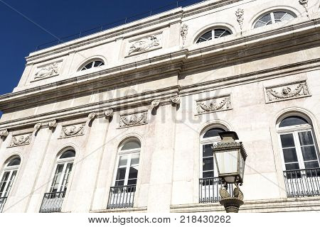 Detail of Neoclassical architecture on the facade of the Dona Maria National Theatre in Lisbon Portugal