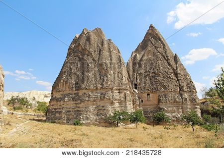 Natural valley with volcanic tuff stone rocks in the evening. Goreme Cappadocia Central Anatolia region of Turkey. Popular tourist destination in Turkey for trekking.