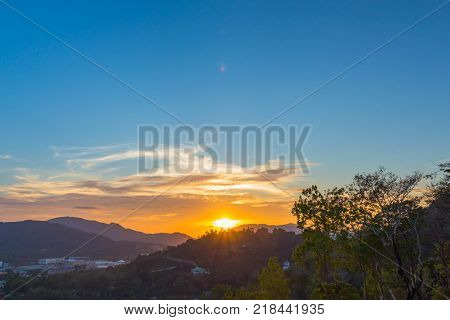 stunning sunset above mountain at Khao Rang viewpoint. Khao Rang viewpoint on hill top in the middle of Phuket town on hill top can see the great big Buddha too