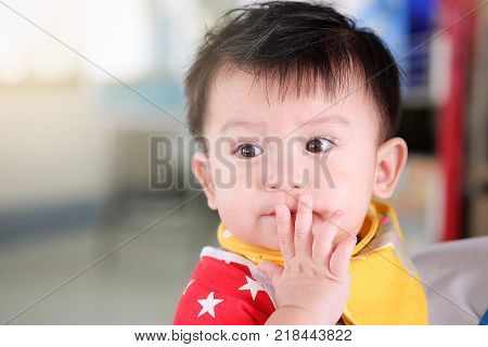 Hands of Asian boys Caught at the mouth and looking poster
