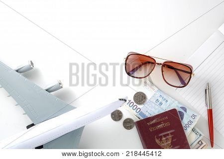 Travel accessories necessary for the holidays passport banknote hat sun glasses, book on a white background