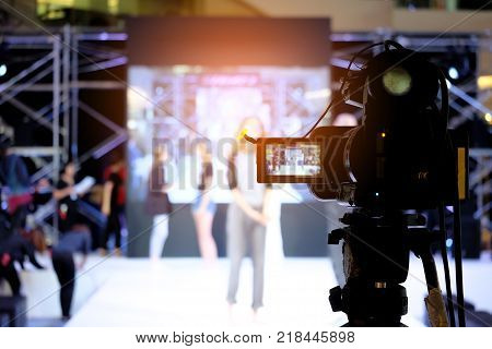 Photographer Video Recording Activity Within The Event