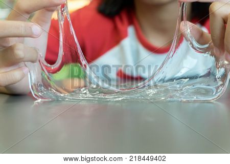 Kid Playing Hand Made Toy Called Slime Selective focus on Slime Teenager having fun and being creative homemade slime.
