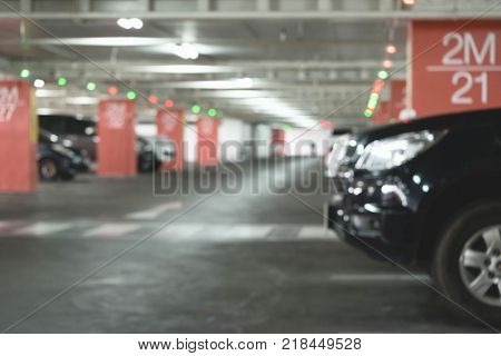 June 7 2017: Car Park in Underground Parking Lot at Shopping Center Soft Focus