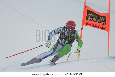 VAL GARDENA, ITALY - DECEMBER 14: Martin Cater of Slovenia races down the Saslong course during the Audi FIS Alpine Ski World Cup Men's Downhill training on December 14 2017