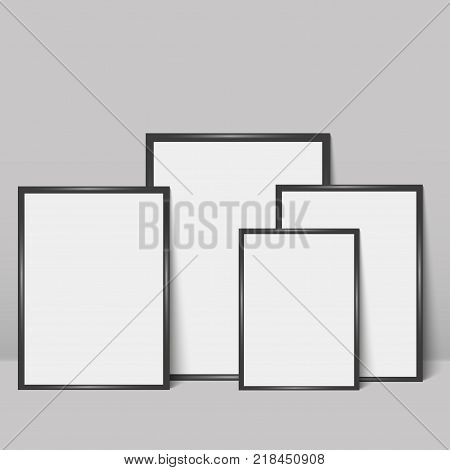 Black photo frames leaning against a grey wall. Vector illustration. Mock up.