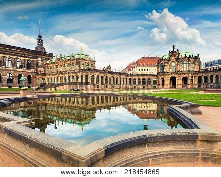 Morning in famous Zwinger palace (Der Dresdner Zwinger) Art Gallery of Dresden. Colorful spring scene in Dresden Saxony Germany Europe. Artistic style post processed photo.