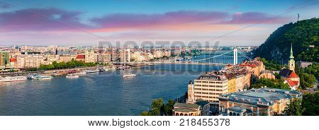 Panoramic cityscape of Pest city with Elisabeth Bridge on the Danube river. Colorful spring sunset in Budapest Hungary Europe. Artistic style post processed photo.