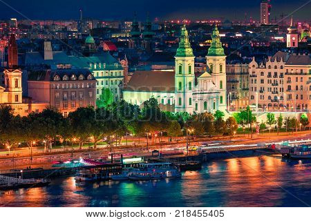 Colorful night view of Inner City parish Church in Pest city. Splendid evening scene in Budapest capital of Hungary Europe. Artistic style post processed photo.