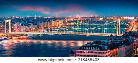 Panoramic cityscape of Pest city with Elisabeth Bridge on the Danube river. Colorful spring sunset in Budapest capital of Hungary Europe. Artistic style post processed photo.