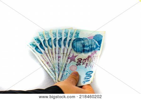 ten bills per 100 lira together making one thousend lira hold in the hand