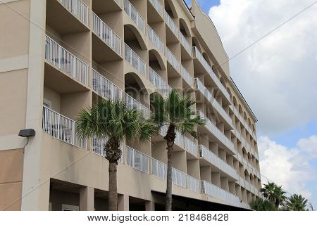 Length of exterior stucco architecture with beautiful balconies overlooking the beach.