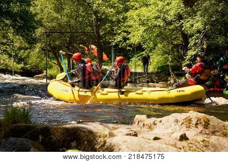 Bala Wales United Kingdom - June 18 2017: White water rafters shooting the rapids at the National White Water Centre on the River Tryweryn in the Snowdonia National Park