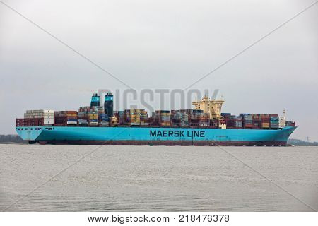 Hollern, Germany - December 15, 2015: Container ship MARIT MAERSK on Elbe river. The vessel can hold up to 10150 standard containers and is owned and operated by Maersk Line, Copenhagen, Denmark.
