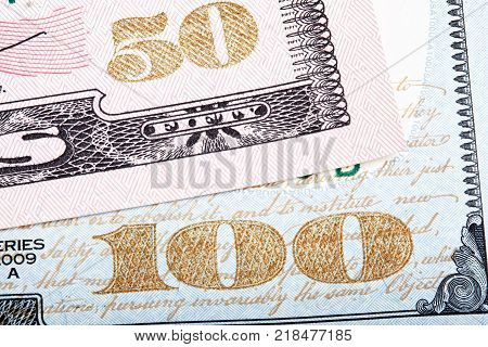 Stacked photo. Detail of new design of 100 and 50 dollars banknote bills.