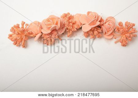 A wreath of plastic flower garland, high quality image with copy space, Artificial  flower wreath, isolated on white with copy space