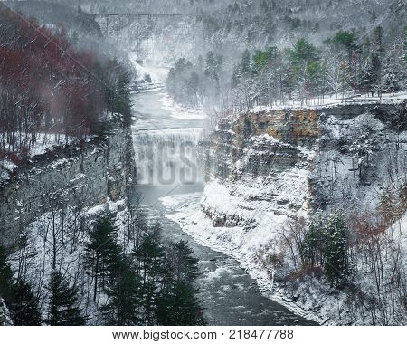 The middle falls along the Genesee River inside the Letchworth State Park. Taken the day after Thanksgiving after a heavy snow store. Upper falls and the train bridge are also seen.