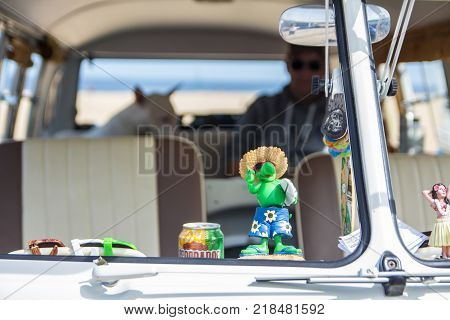 Scheveningen The Hague the Netherlands - 21 May 2017: interior of VW kombi van at the beach with dog and owner