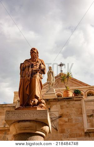 Close up beautiful statue of Saint Jerome or Hieronymus in Bethlehem, Palestine Authority