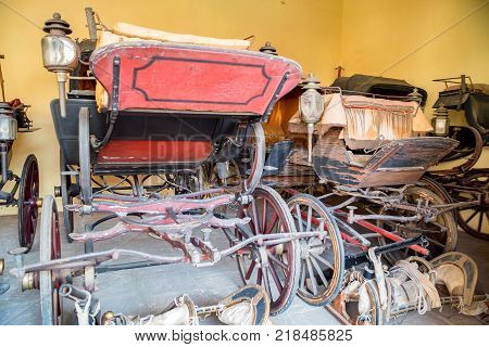 Close up bright carriages used by maharajas on display in Indian pale in Jaipur