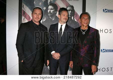 LOS ANGELES - DEC 14:  Christian Bale, Scott Cooper, Wes Studi at the