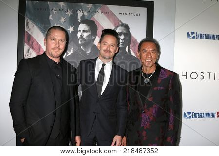 LOS ANGELES - DEC 14:  Christian Bale, Scott Cooper, Wes Studi at the