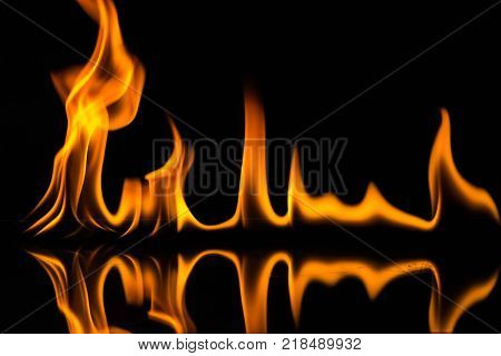 Flame isolated on black background, bright fire