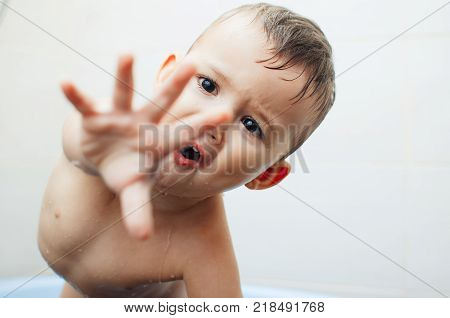 The Child In The Bathroom With Your Hands Shows The Gesture Of Negation