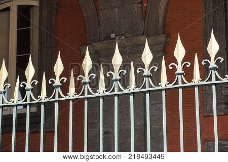 Beautiful wrought fence. Image of a decorative cast iron fence. metal fence close up. Metal Forged Fence