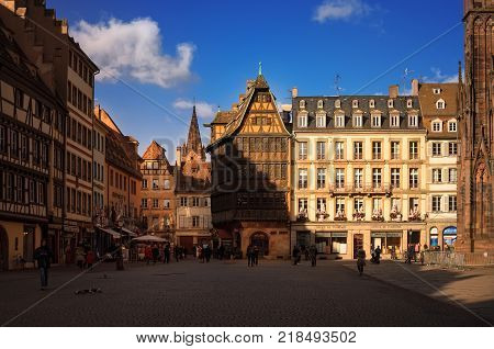 STRASBOURG, FRANCE - JANUARY 5, 2017: Cathedral Square in old sity. View of traditional half - timbered house Kammerzell - most famous secular building in Strasbourg . Alsace, France.