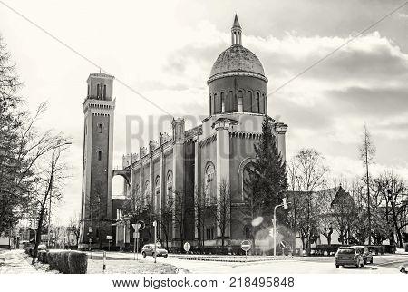 New evangelical church in backlight Kezmarok Slovak republic. Religious architecture. Travel destination. Black and white photo.