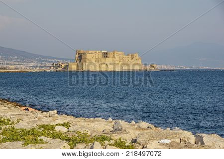 Castel dell'Ovo italian for the Egg fortress in the port of Naples in Italy, with the Gulf of Naples .