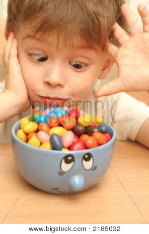 Emotions Of The Child Which Looks At Sweets