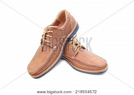 Brown leather shoes on isolated white background