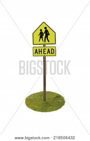 Ahead sign people crossing with pole and green lawn.