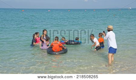 PattayaThailand- November 22;2017: Sai Kaew Beach Sattahip-Military Beach. Children play in the water and bathe. Mom takes pictures