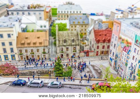 Quebec City Canada - May 30 2017: Cityscape or skyline of lower old town buildings with view of Parc de la Cetiere and mural fresco called trompe-l'oeil