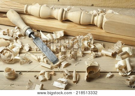 Carpentry concept.Joiner carpenter workplace. Old chisel and wooden workpiece on the table. Copy space for text.