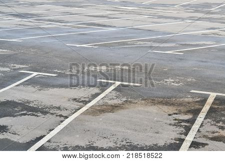Detail of an empty parking place with marked slots